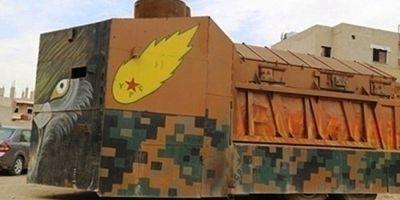 Adevaratii luptatori impotriva Statului Islamic: kurzii si-au facut tancuri din tractoare, decorate pentru a-i inspaimanta pe jihadisti