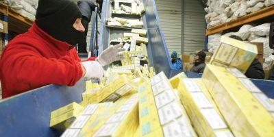 Cum au reusit vamesii sa distruga doar in acte mii de pachete de tigari de contrabanda confiscate. Marfa se intorcea pe piata neagra